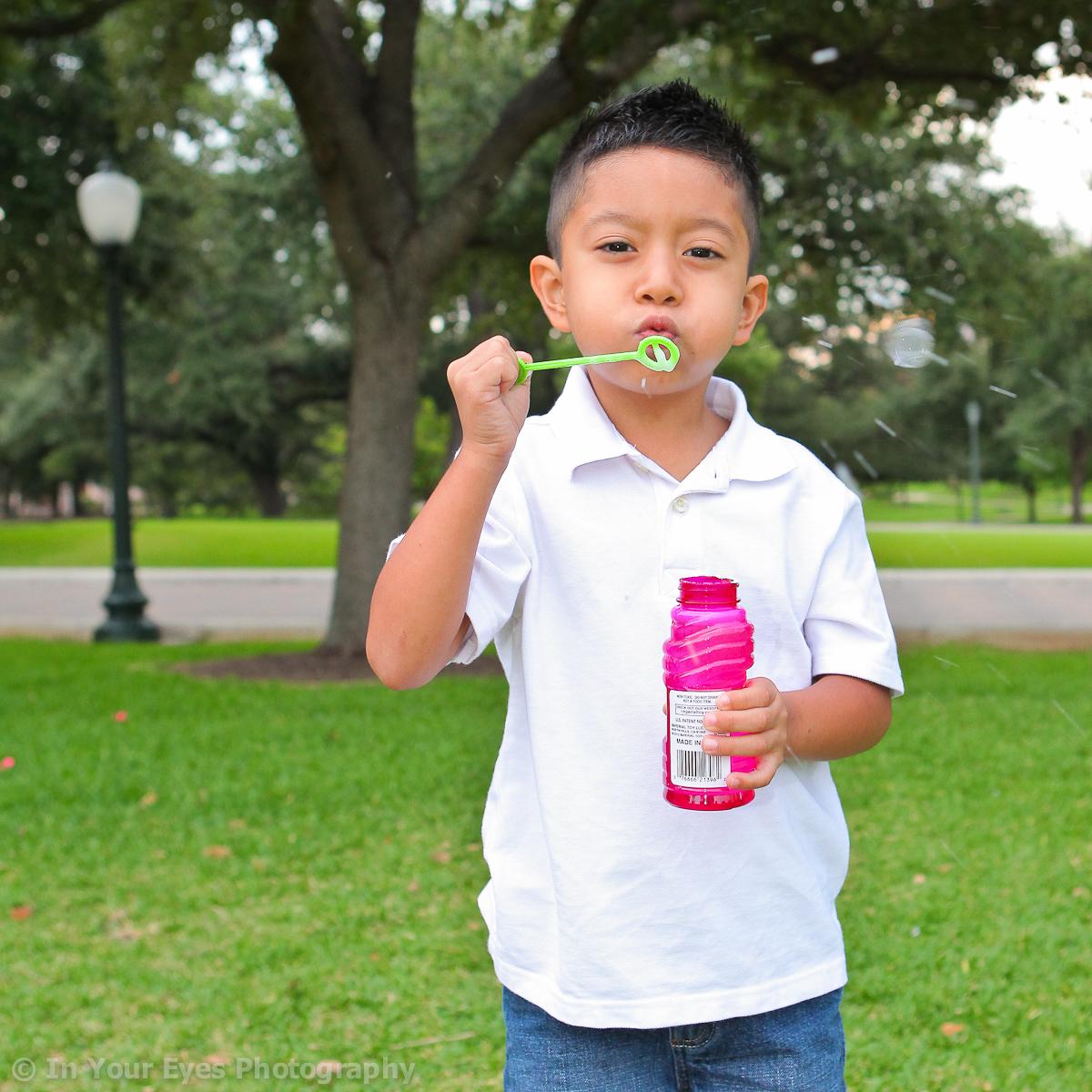 boy blowing bubbles Austin, Texas family portraits family photographers