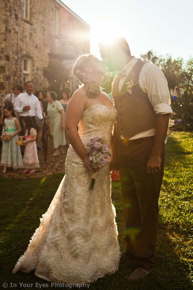 bride and groom with sun flare